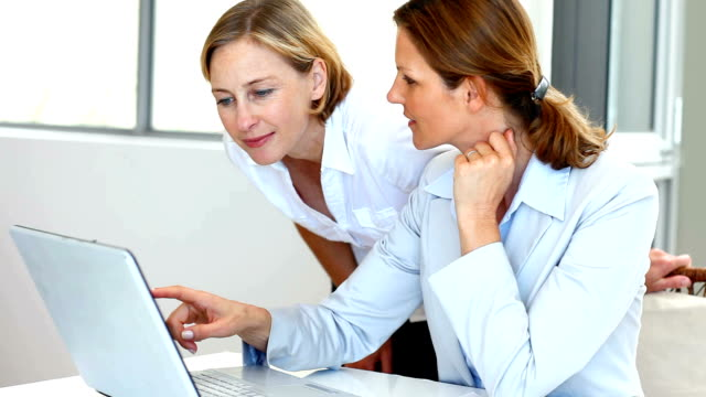 successful businesswomen working together in office - administrator stock videos and b-roll footage