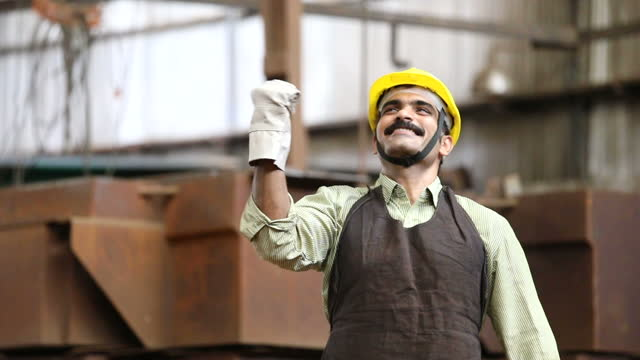 successful engineer celebrating success at factory - engineer stock videos & royalty-free footage
