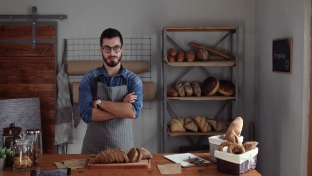 successful entrepreneur in his bakery - apron stock videos & royalty-free footage
