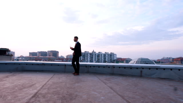 successful investor walking on rooftop - on top of stock videos & royalty-free footage