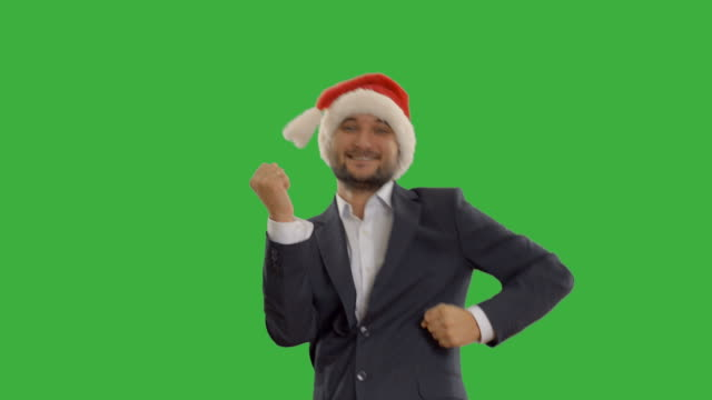 successful man dancing and calls to join him - santa hat stock videos & royalty-free footage