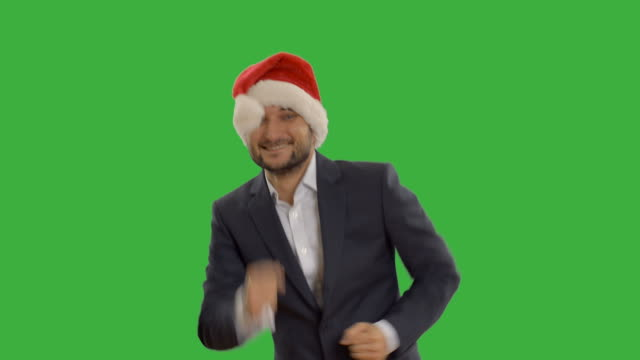 successful man dancing and showing thumb - santa hat stock videos & royalty-free footage