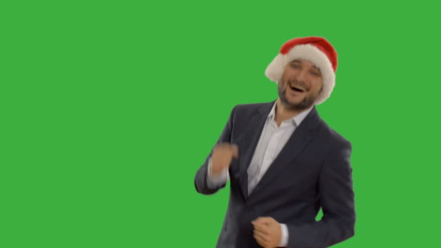 successful man is spinning and calls to join him - santa hat stock videos & royalty-free footage