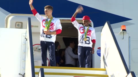 successful team gb athletes posing with their medals on the heathrow runway after they return from the rio olympics - medal stock videos & royalty-free footage