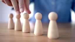 Successful team leader, Businesswoman hand choose people standing out from the crowd.