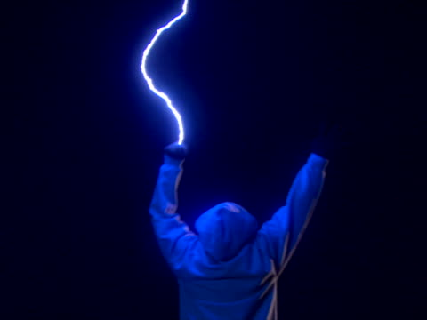 successive strikes hitting man's upstretched hands - tesla coil stock videos and b-roll footage