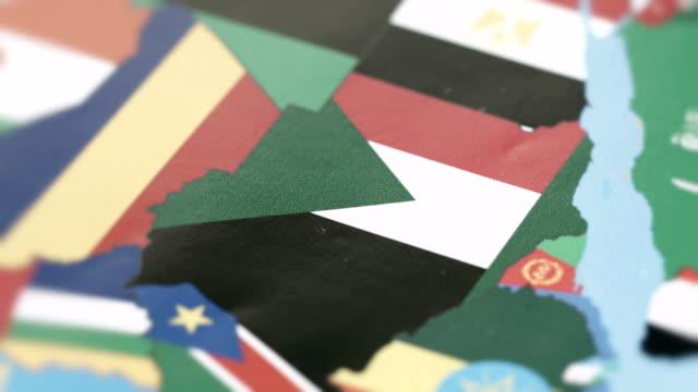 vídeos de stock e filmes b-roll de sudan borders with national flag on world map - etiópia ouro