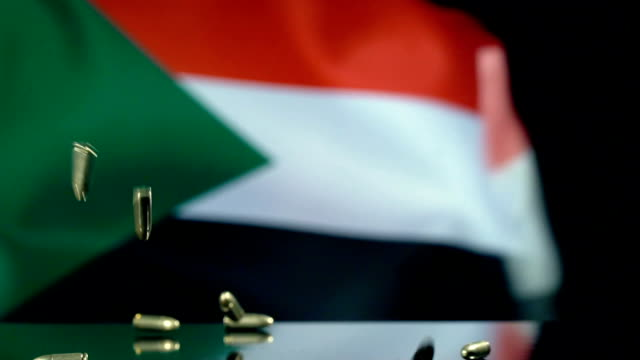 sudan flag behind bullets falling in slow motion - world war one stock videos & royalty-free footage