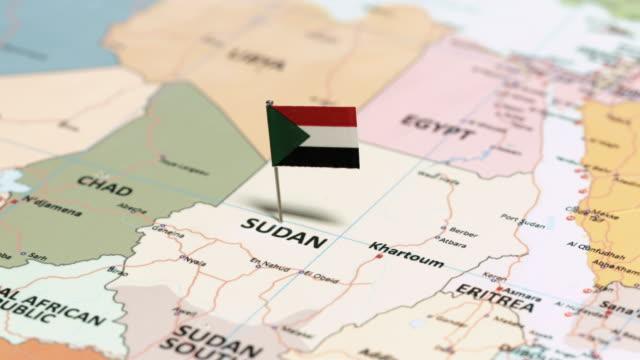vídeos de stock e filmes b-roll de sudan with national flag - etiópia ouro
