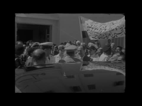 sudanese delegation in cairo; egypt: cairo: ext gv group towards flags on airport buildings int bv / mr zakaria mohie el-din talking to press 2... - 1950 1959 stock videos & royalty-free footage