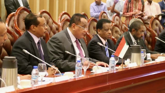 sudanese foreign minister ibrahim ghandour and foreign minister of egypt sameh shoukry speak during delegation committee meeting between sudan and... - government minister stock videos & royalty-free footage