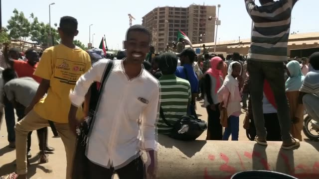 Sudanese military attempts to break up mass sitin outside its headquarters in Khartoum SUDAN Khartoum EXT People massed outside headquarters