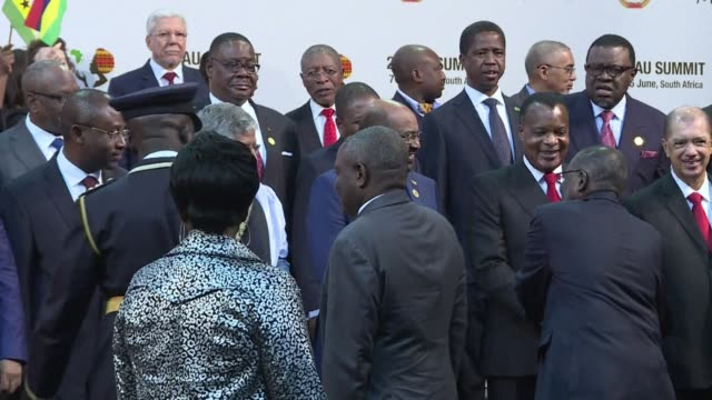 sudanese president omar al bashir joined a group photograph of leaders at the african union summit in johannesburg on sunday despite the... - international criminal court stock videos and b-roll footage
