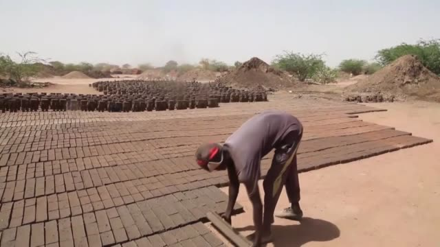 sudanese workers make clay bricks at a traditional brick factory on the banks of the nile river in aljarif near khartoum sudan on july 04 2017 - brick stock videos & royalty-free footage