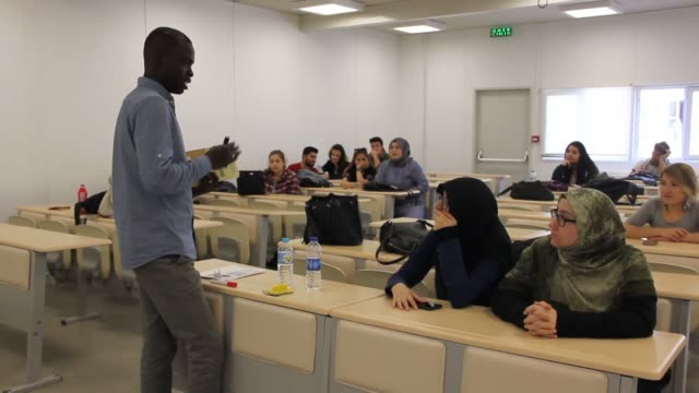 sudanese youth, who came to turkey to pursue his master and doctorate in turkish language and literature, is now surprising turks by teaching turkish... - literature stock videos & royalty-free footage