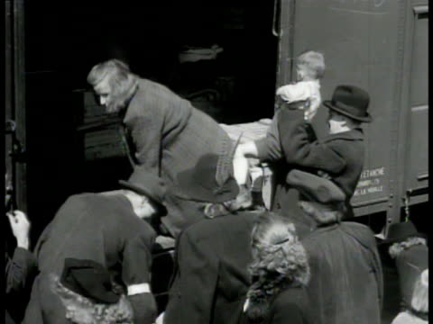 sudetenland refugees boarding train - ethnic germans who had moved into czecholovakia under hitler are being sent back to germany / people, families... - postwar stock videos & royalty-free footage