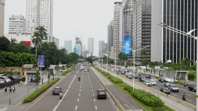 sudirman street in jakarta - indonesia street stock videos & royalty-free footage