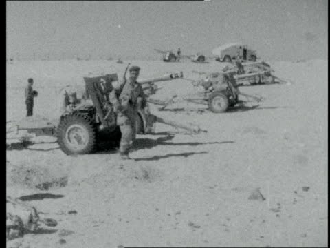 israel advance into egypt:; egypt: sinai area: ext nitzana area with abandoned egyptian equipment - tanks - ammunition - motorcyle: israeli soldiers... - canale di suez video stock e b–roll