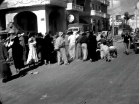 stockvideo's en b-roll-footage met scenes in port said egypt port said ext pan captured rifles / mcu russian rifles / soldier looking at russian rifle and showing permanently fitted... - 1956