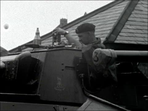 troops in Windsor prepare for action ENGLAND Berkshire Windsor EXT Wide shots Windsor Castle / Gates to army barracks / Regimental flag / Shots of...