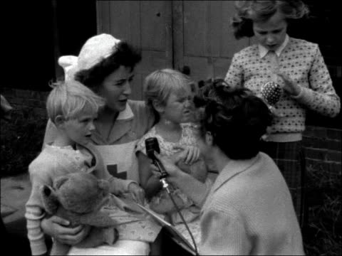 stockvideo's en b-roll-footage met wrac's provide shelter for mothers and children evacuated from egypt to london england london richmond park ext sign for 'headquarters 12th battalion... - suezcrisis