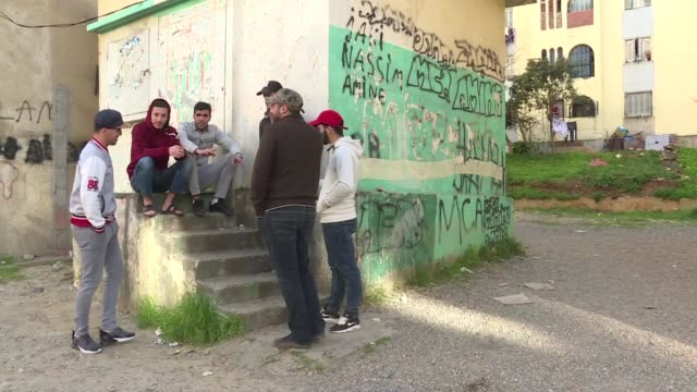 suffering from lack of work and affordable housing the young residents of a poverty hit housing project outside algeria's capital have lost all hope... - disoccupazione video stock e b–roll