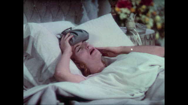 vídeos de stock, filmes e b-roll de 1937 a suffering woman (carole lombard) whines and wails through her morning hangover - doença