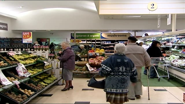 suffolk bird flu outbreak: import controls / supermarket sales; date unknown ??? int shoppers in vegetable aisle of supermarket bernard matthews... - roast turkey stock videos & royalty-free footage
