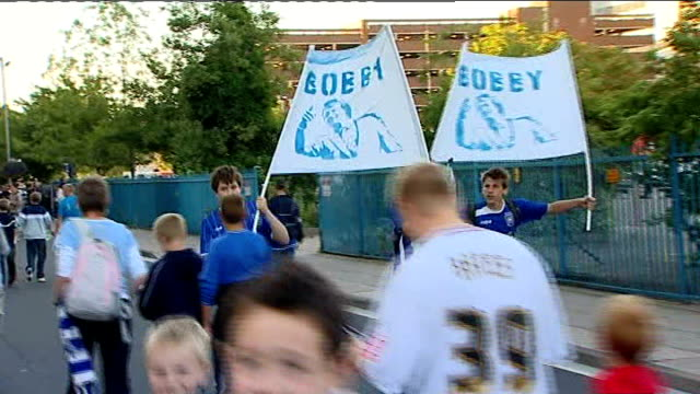 portman road: ipswich town football club: ext ipswich football fans walking along road with 'bobby' banners as arriving for friendly match against... - organised group photo stock videos & royalty-free footage