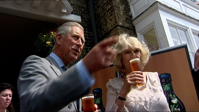 suffolk southwold photography*** prince charles and camilla tasting beer duiring visit to adnams brewery and charles commenting sot i haven't got any... - v neck stock videos & royalty-free footage