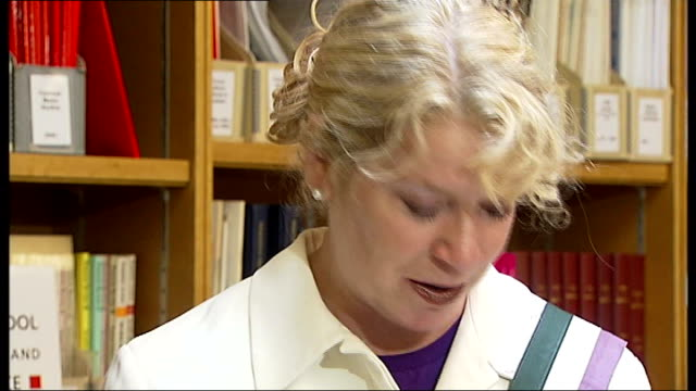 100th anniversary of emily wilding davison's death; london: lse: women's library: int philippa bilton set up shots with reporter personal items... - 100. jahrestag stock-videos und b-roll-filmmaterial