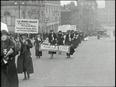 suffragettes carrying signs and banners march in front of the capitol building in albany, new york. - 1918 stock videos & royalty-free footage