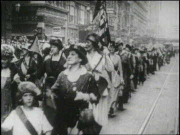 suffragettes march in a parade for women's rights. - frauenrechte stock-videos und b-roll-filmmaterial