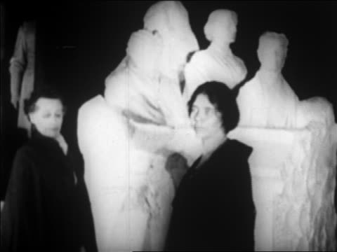 B/W 1920 2 suffragettes standing by statue / newsreel
