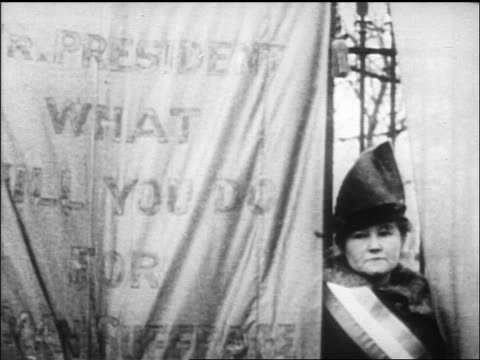 suffragist standing by banner + looking at camera / newsreel - 1917 stock videos & royalty-free footage