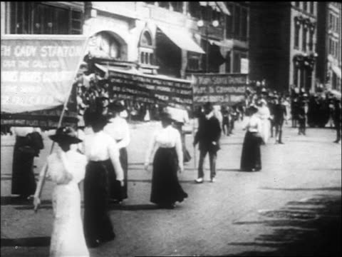 suffragists with banners marching in parade / washington, d.c. / newsreel - 1917 stock videos & royalty-free footage