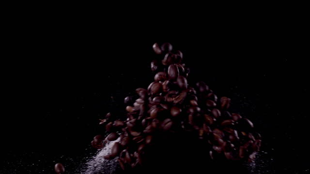 sugar and coffee beans colliding in the air super slow motion video 1000 fps - coffee variation stock videos & royalty-free footage