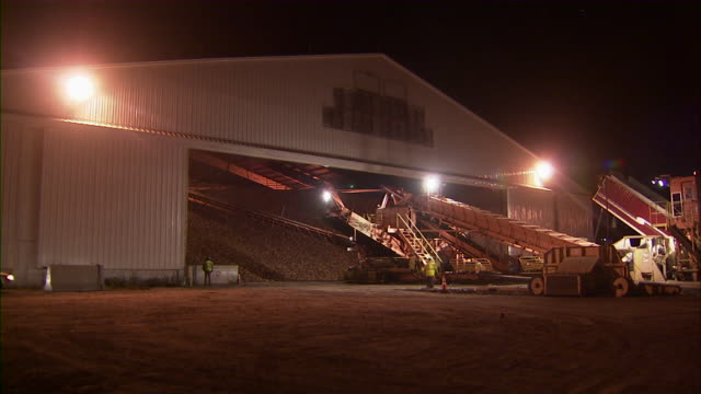ls of sugar beets in enormous piles in warehouse. - 駐車場点の映像素材/bロール