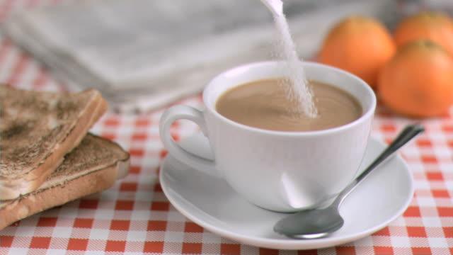 sugar being poured in super slow motion - zucker stock-videos und b-roll-filmmaterial