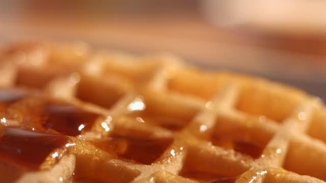 vídeos y material grabado en eventos de stock de cu td cu slo mo sugar being poured on waffle top from above / manchester, united kingdom - waffles