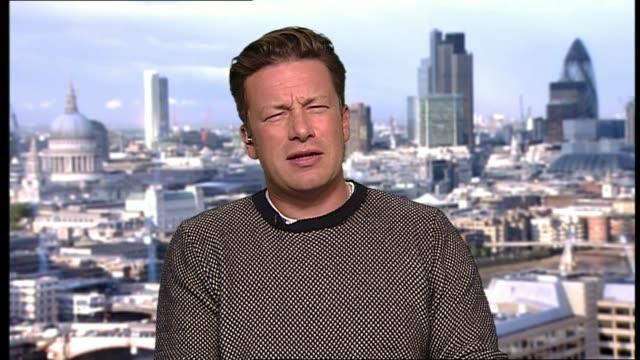 sugar blamed for obesity crisis: jamie oliver documentary; gir: int jamie oliver 2-way interview from central london sot - jamie oliver stock videos & royalty-free footage