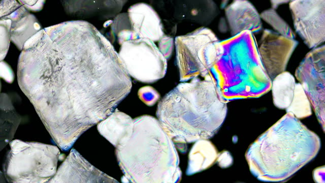 sugar crystallization under polarized light 4k timelapse - refraction stock videos & royalty-free footage