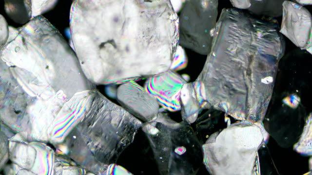sugar crystallization under polarized light 4k timelapse - polarizer stock videos & royalty-free footage