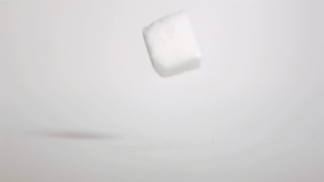 sugar cube falling down in super slow motion - sugar cube stock videos & royalty-free footage