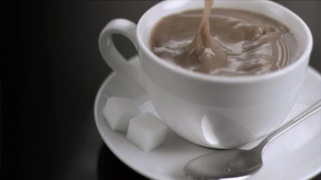 sugar cube falling in super slow motion - sugar cube stock videos & royalty-free footage