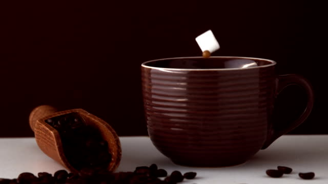 sugar cube falling into brown coffee cup - sugar cube stock videos & royalty-free footage