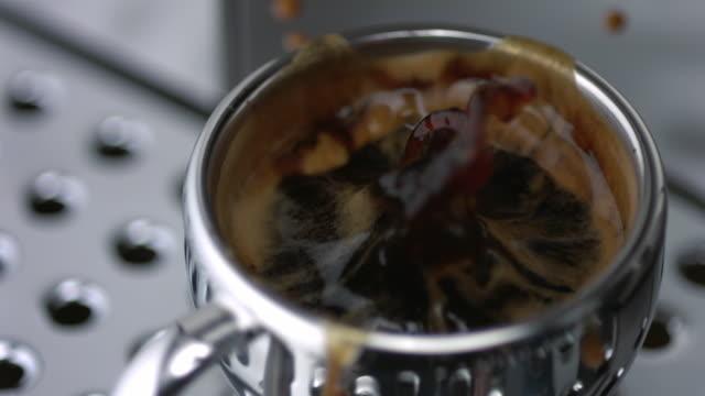 slo mo ecu sugar cube falling into coffee - sugar cube stock videos & royalty-free footage