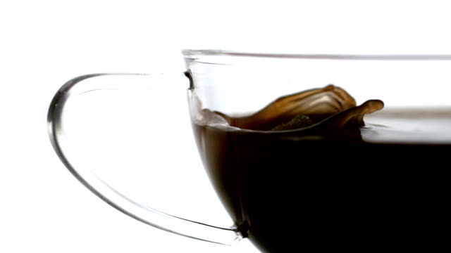 sugar cube falling into cup of coffee - sugar cube stock videos & royalty-free footage