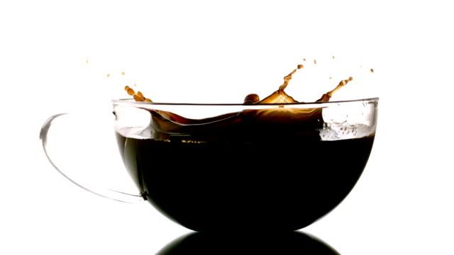 sugar cube falling into cup of tea - sugar cube stock videos & royalty-free footage
