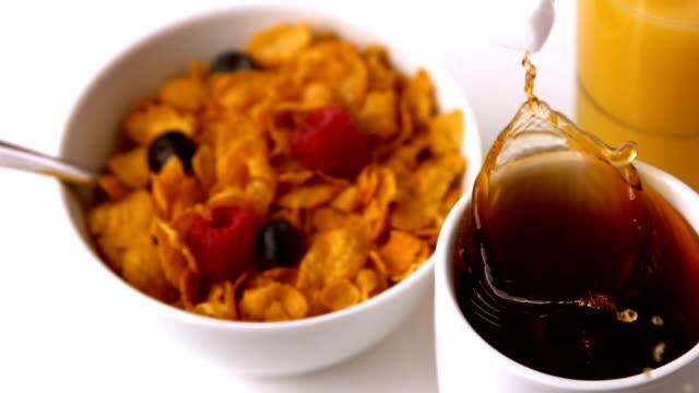 sugar cube falling into mug at breakfast table - sugar cube stock videos & royalty-free footage